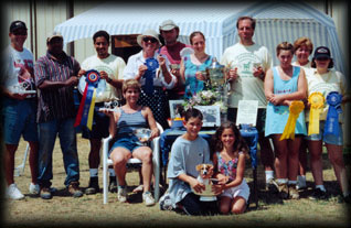 Winner's Circle Horse Farm, group photo, holding trophy wins 1998